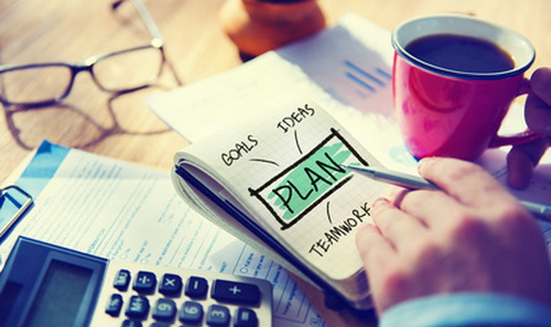 Businessman Writing Plan Goals Vision Concept